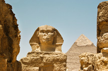 The Sphinx and a pyramid in Giza, Egypt.