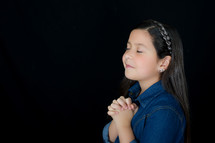 A girl with praying hands