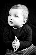 infant boy with prayer hands