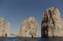 rock formations along a shore in Italy