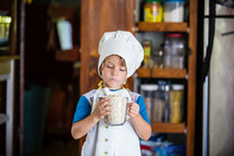 a child cooking in the kitchen
