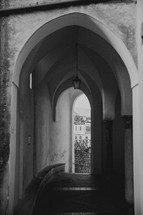 arched tunnel over a narrow street in Italy