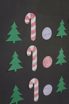 Christmas cutouts on a chalkboard