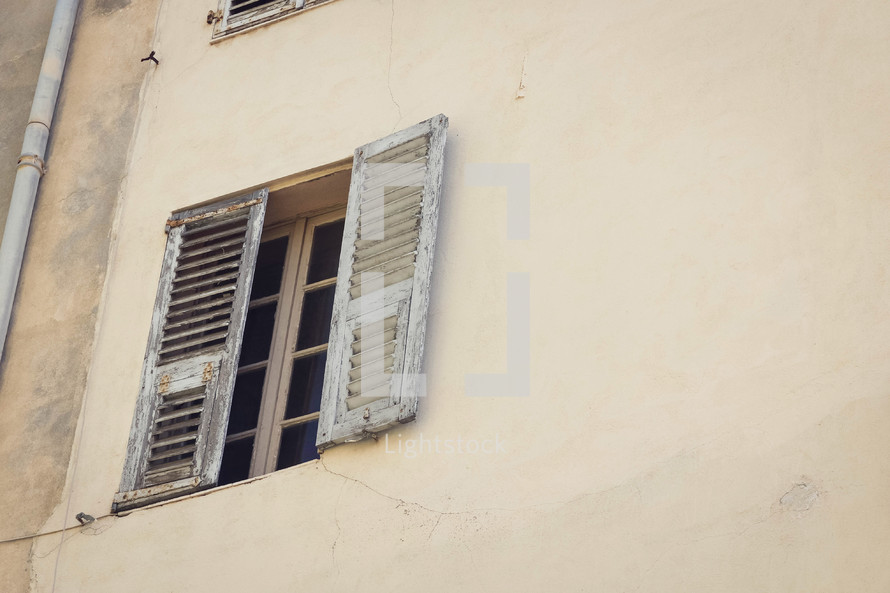 wooden shutters on a window in Italy