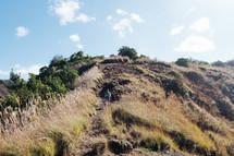 man exploring a mountainside