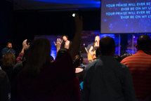 parishioners in song at a worship service