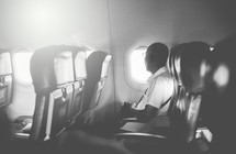 a man sitting alone on an airplane