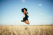 a woman in mid-air in a field