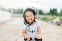 a little girl on a scooter