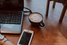 cappuccino, laptop, and cellphone