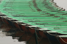 row of rowing boats on the water