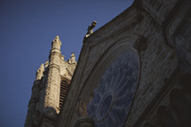 Looking up at an old cathedral