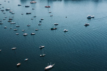 aerial view over anchored boats in a bay