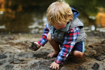 boy child playing in mud