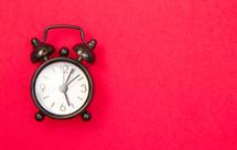 alarm clock on red