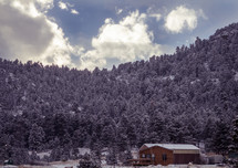 a cabin in the snow dust mountains