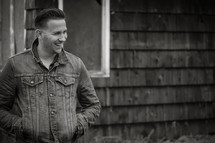 man standing outdoors in a jean jacket