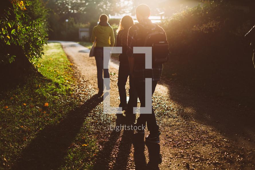 teenagers walking home from school
