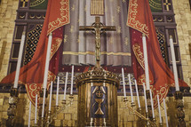 A holy altar with candelabras and a crucifix