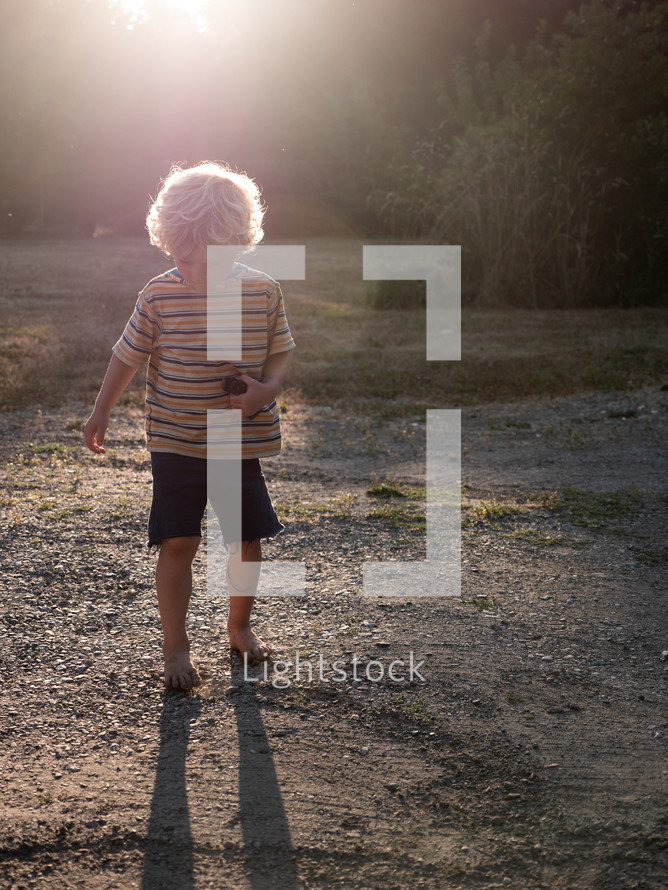 barefoot child playing outdoors