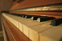 Closeup of ebony and ivory keys on an antique piano