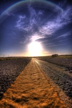 sun halo over road asphalt