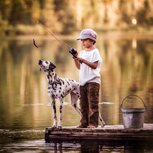 boy and his dog fishing