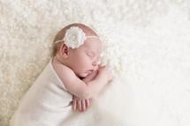 a sleeping newborn girl