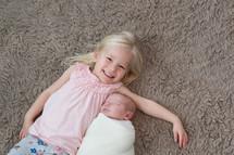 big sister with a newborn