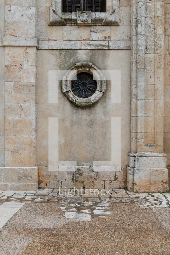 circular window on a stone building