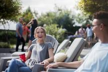 friends talking at a backyard summer party