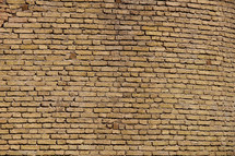 Tan brick wall made from hand made bricks