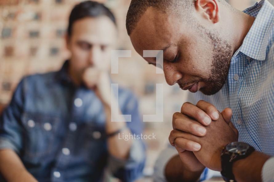 men in prayer at a Prayer group