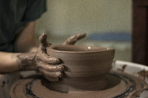 potter forming clay