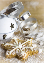 star Christmas cookie and bell with ribbon