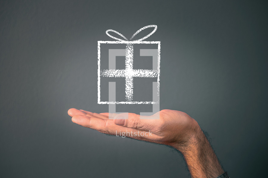a chalk outline of a gift tied with a bow, supported by an outstretched hand on a grey background