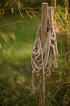 rope hanging on a fence post