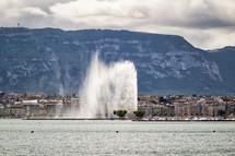 fountain along a shoreline in Switzerland