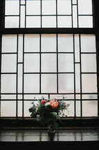 floral arrangement in a window