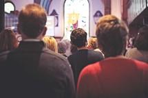 parishioners worshiping