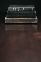 stack of books and a Bible