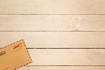 envelope on a wood background