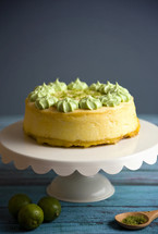 key lime cake on a cake stand