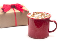 gift and mug of hot cocoa