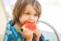 toddler girl eating watermelon
