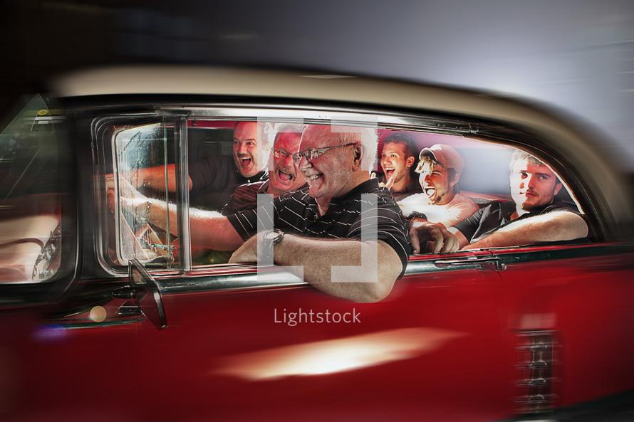 Men laughing inside a vintage red car