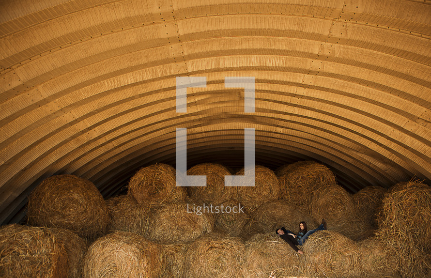 hay stacks and a couple