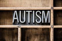 word autism on a bookshelf