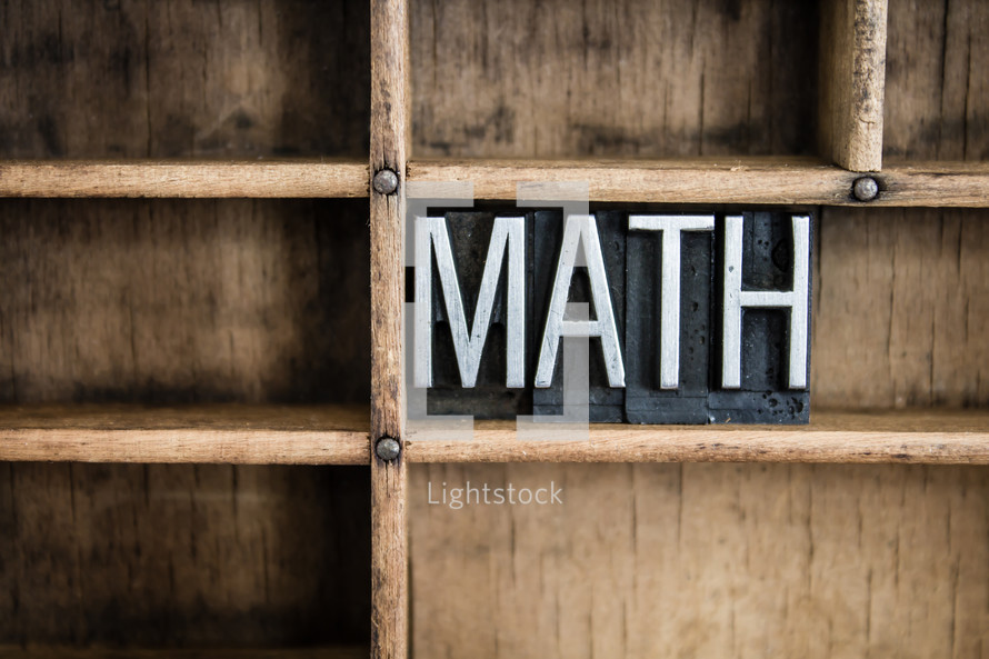 word math in blocks on a bookshelf
