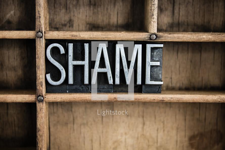 word shame on a shelf